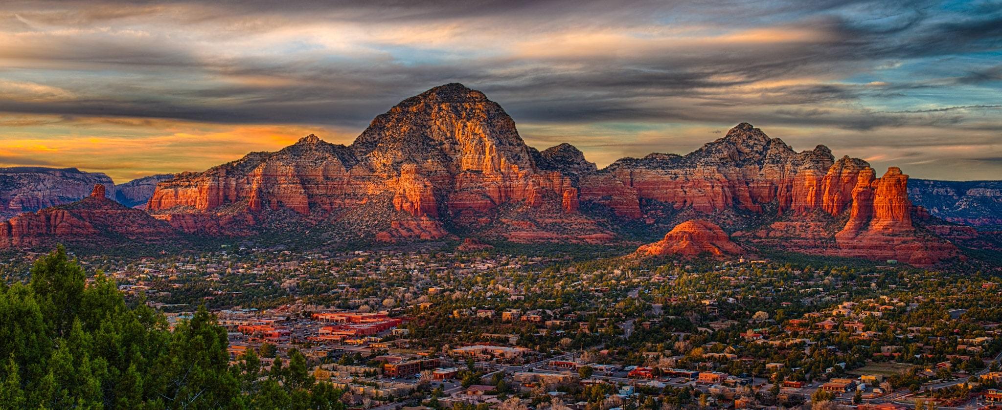 The last light of day illuminates the iconic rock formations that provide a backdrop to Sedona, Arizona.
