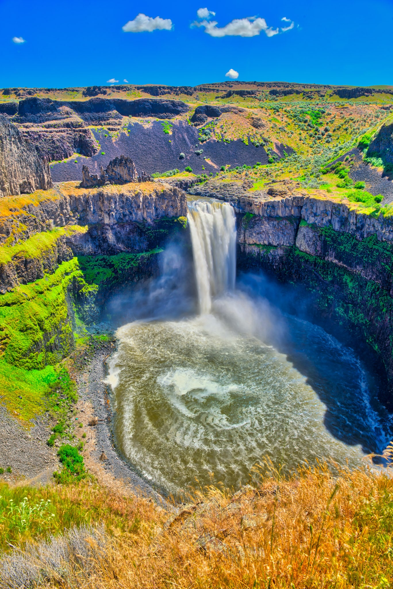 Palouse Falls, in Palouse Falls State Park, plunges 186 feet into a large plunge pool. It is one of several falls and cascades on the Palouse River. It is located between Spokane and Walla Walla, Washington.