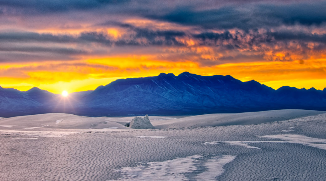 Sun sets over the gypsum sands of White Sands National Monument in New Mexico.