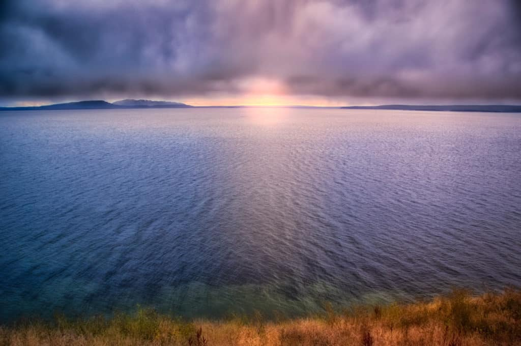 Stormy Sunset at Yellowstone Lake from Steamboat Point in Yellowstone National Park, Wyoming.