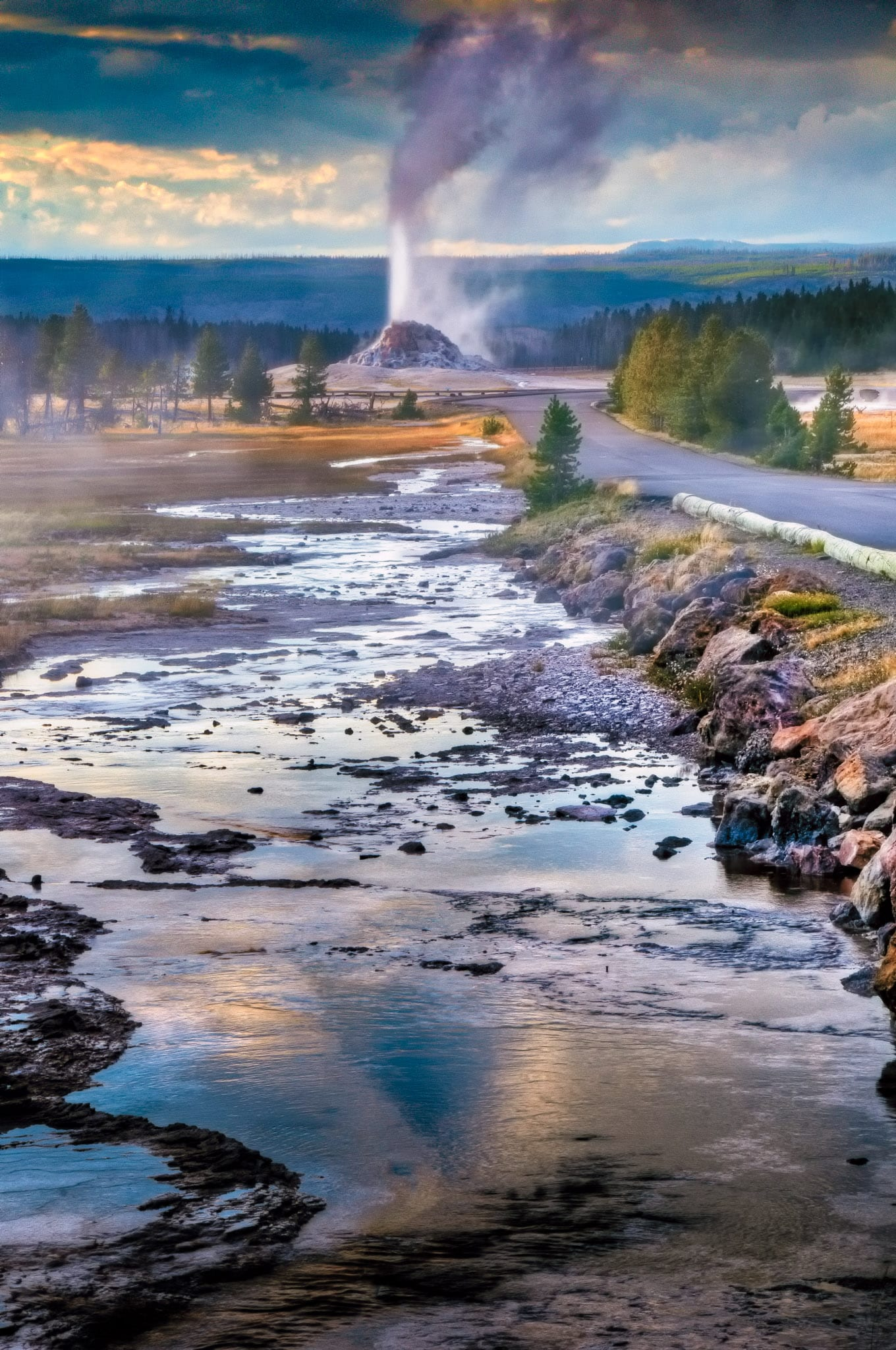 Runoff from Great Fountain Geyser heads to erupting White Dome Geyser in Yellowstone National Park, Wyoming.