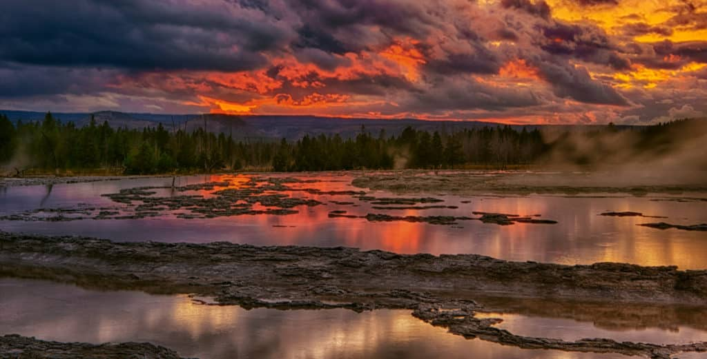 View of Great Fountain Geyser at sunset in Yellowstone National Park, Wyoming.