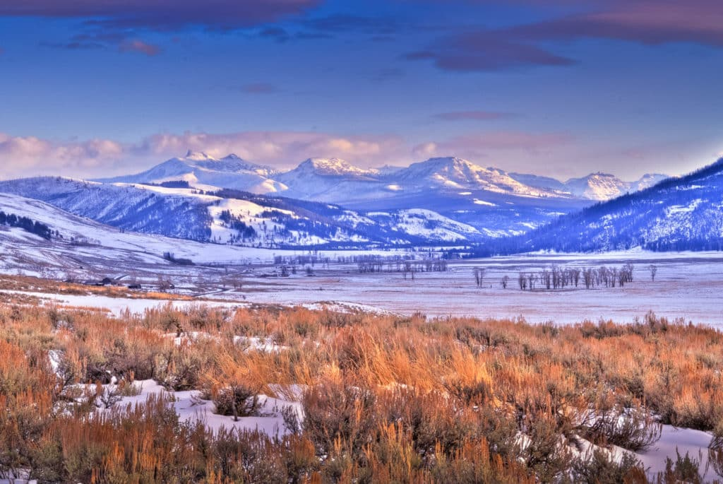 Looking northwest up the Lamar Valley in Yellowstone National Park about a half hour before the sun went behind the mountains to the southeast. The mountain in the distance is Saddleback Mountain.