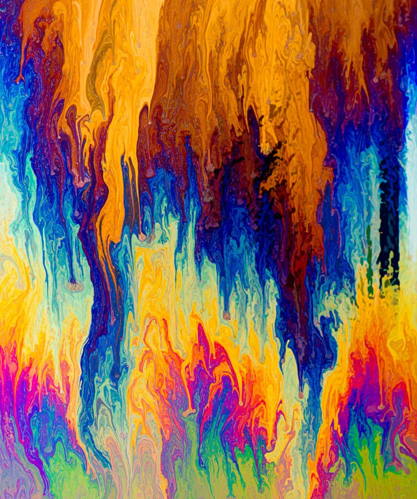 Colorful soapy solution suspended on a rectangular wire looking like flames.