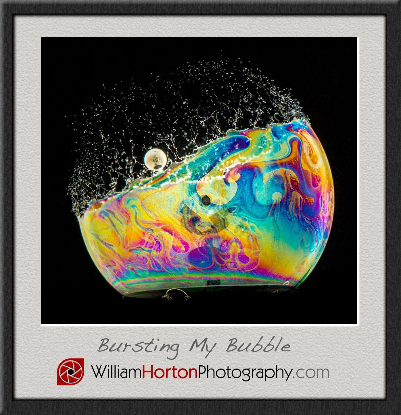 A pellet bursts a colorful bubble.