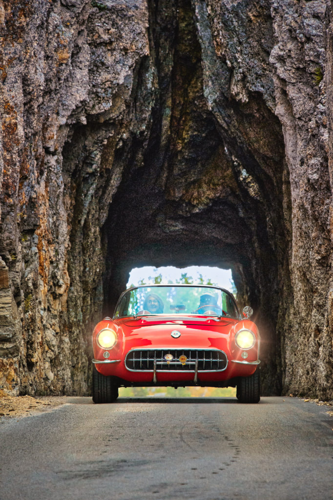 A classic Corvette comes through the tunnel near Need;es Eye on the Needles Eye Highway in Custer State Park near Custer, South Dakota.