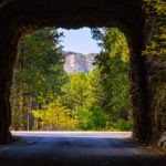 The presidents of Mount Rushmore are nicely framed by one of several tunnels on the Iron Mountain Highway in the Black Hills National Forest of South Dakota.