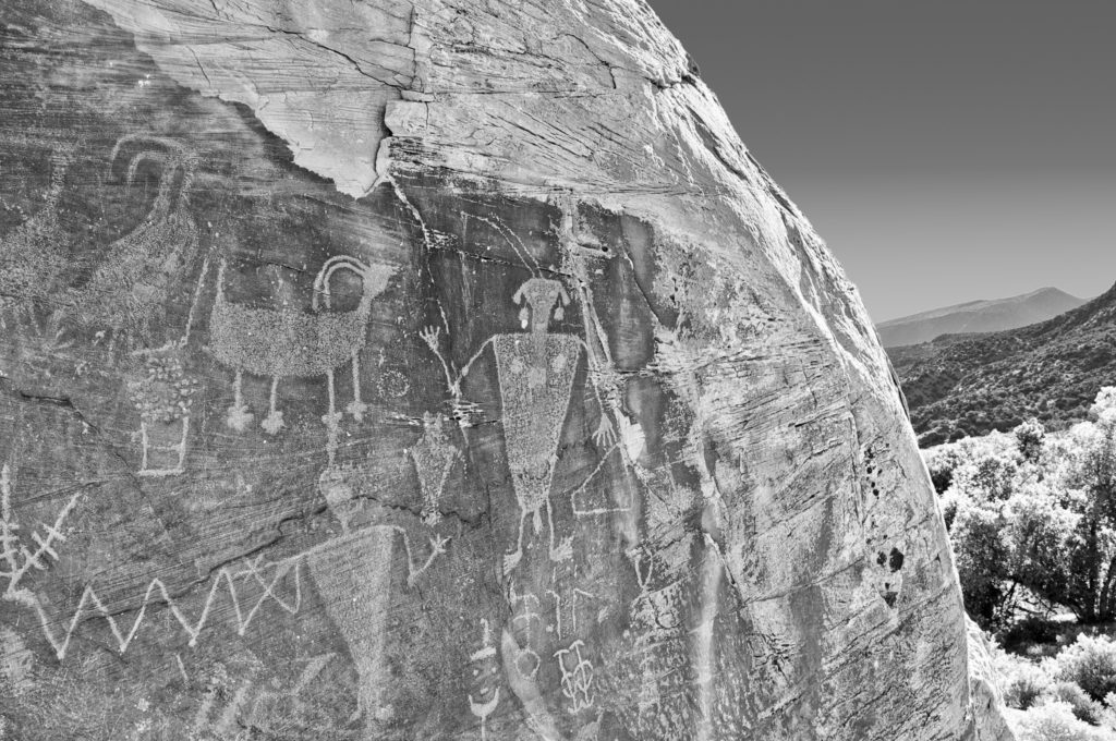 Closeup of petroglyphs on rock overlooking Cub Creek In Dinosaur National Monument.