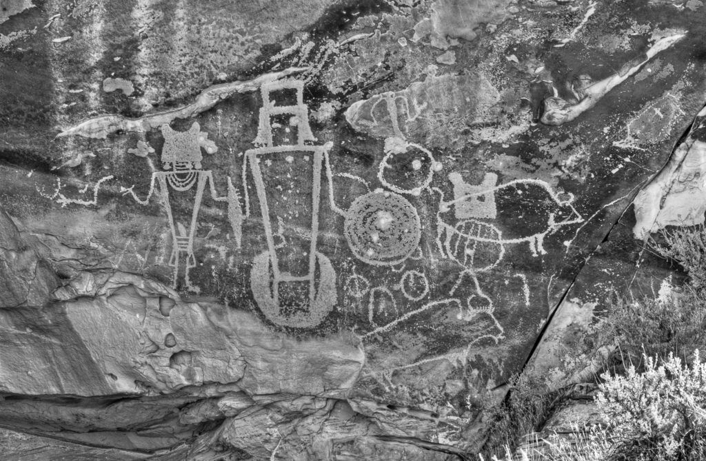 "Petroglyphs in ""Swelter Shelter"" are thought to be from the Fremont Culture. Swelter Shelter is located along Cub Creek Road in Dinosaur National Monument near Vernal Utah."