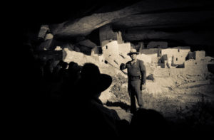 An Interpretive Ranger talks to a group of visitors in Cliff Palace at Mesa Verde National Park near Cortez, Colorado.