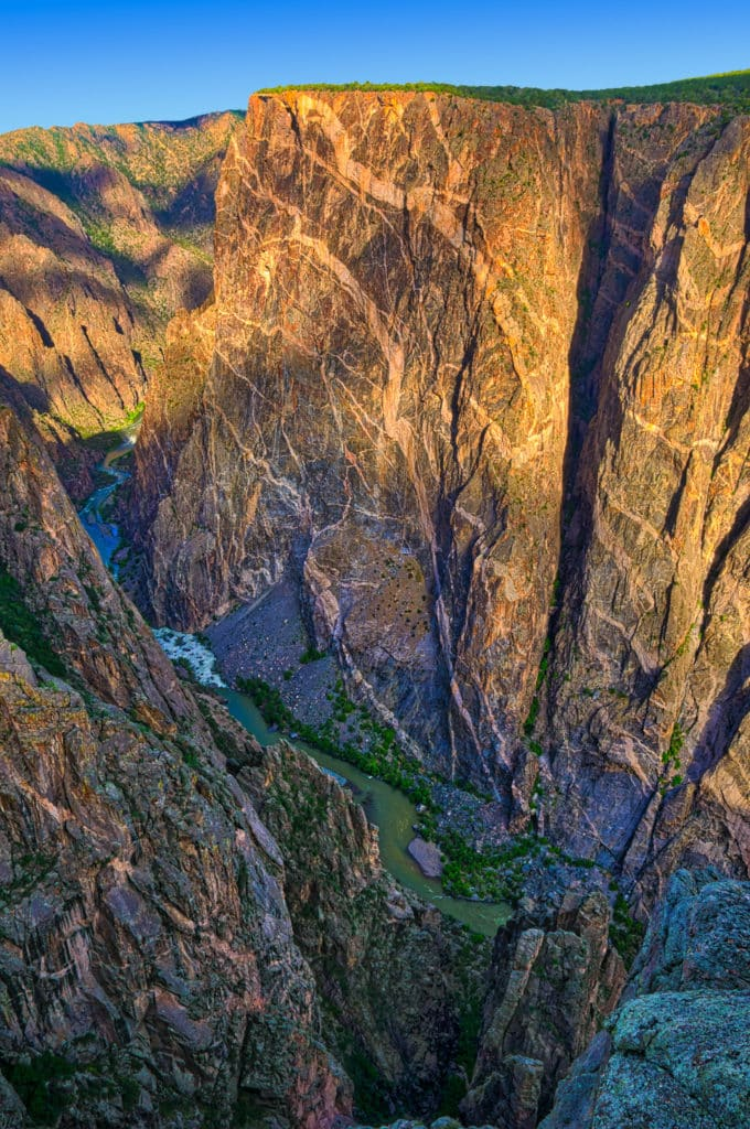 Early morning view of the Painted Wall and the Gunnison River from the south rim of the Black Canyon of the Gunnison National Park near Montrose, Colorado.