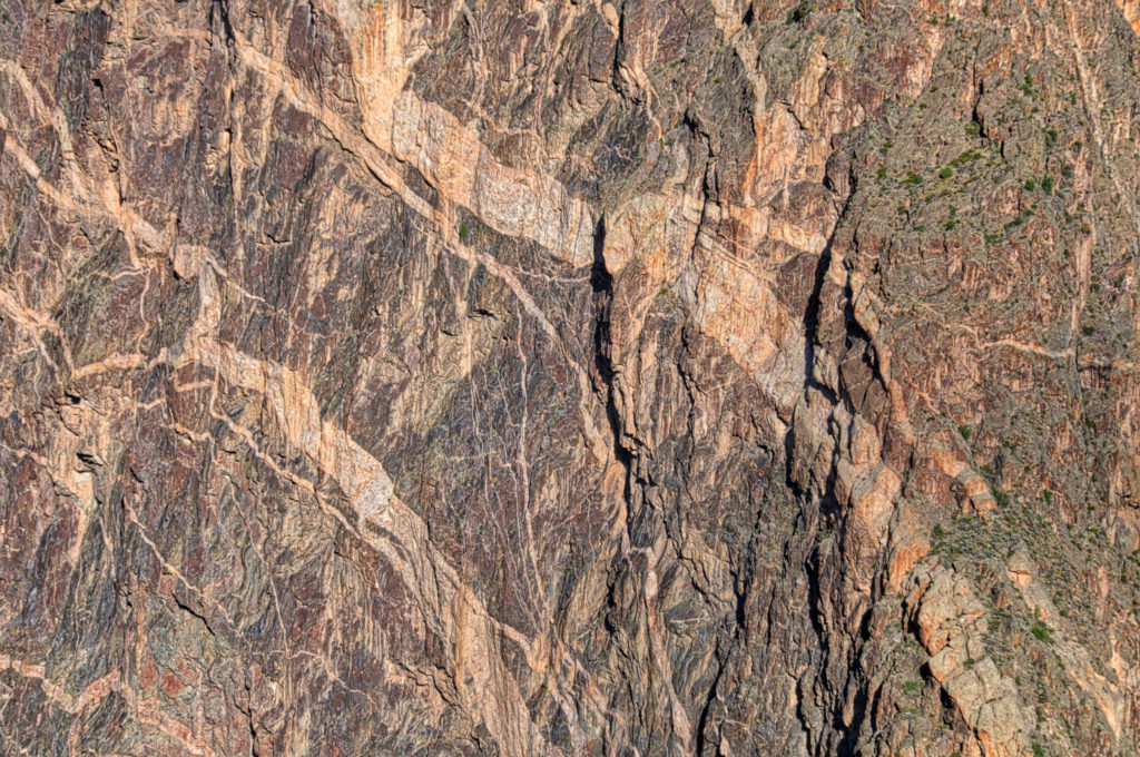 This is a detail of the feldspar pegmatites intruded into the 1.8 billion-year-old gneiss of the Painted Wall. taken from Dragon Point in Black Canyon of the Gunnison National Park near Montrose, Colorado.