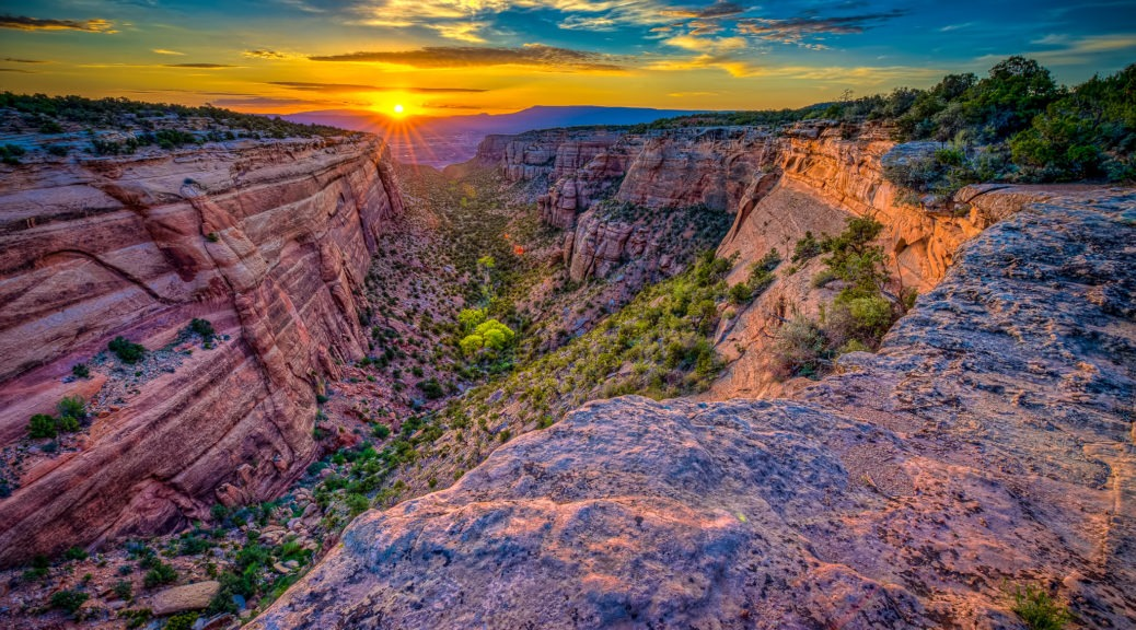 Sunrise illuminates Red Canyon in Colorado National Monument, near Grand Junction, on the Colorado Plateau.