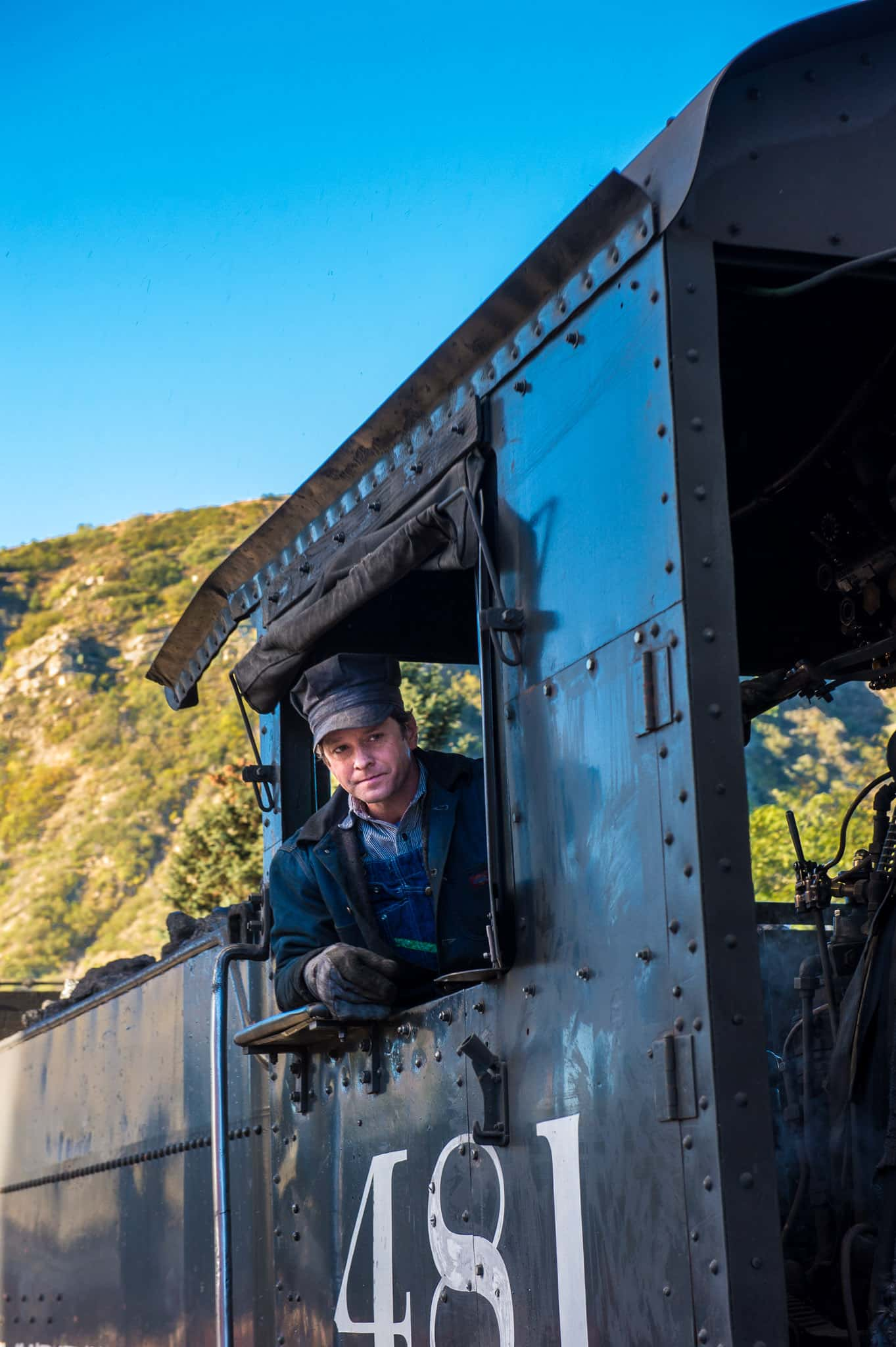 Portrait of the engineer of the Durango & Silverton Photography train as it makes its way along the Animas River between Durango and Silverton, Colorado.