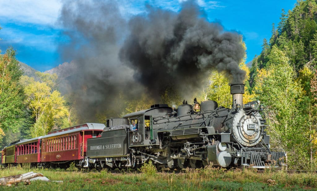 View of the autumn Durqango & Silverton Photography train as it makes its way along the Animas River between Durango and Silverton, Colorado.