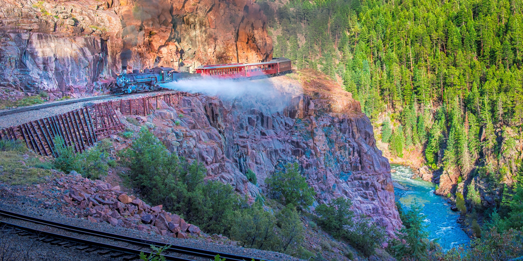 View of the autumn Durqango & Silverton Photography train as it makes its way along the Animas River between Durango and Silverton, Colorado.