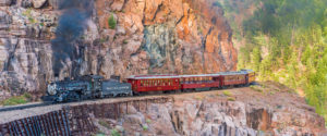 View of the autumn Durqango & Silverton Photography train as it makes its way along the Animas River between Durango and Silverton, Colorado. Durango & Silverton Historic Train