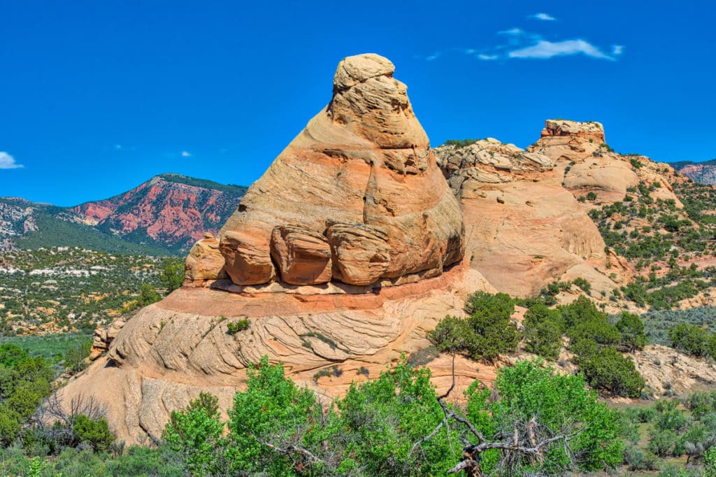 This photo of Elephant Toes Butte was taken along Blue Mountain Road, off of Cub Creek Road in Dinosaur National Monument, Utah. The formation has eroded out of the Glen Canyon Group sandstone. And, the interbedded layering testifies to its ancient sand-dune origins.