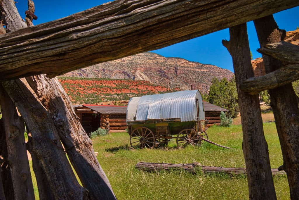 The old Chew Ranch lies on both sides of Echo Park Road in Dinosaur National Monument, Colorado. The surrounding cliffs provided protection and water to pioneer settlers in the late 1800s and early 1900s.. This picturesque sheep wagon provided shelter for folks looking after the wide-ranging livestock.