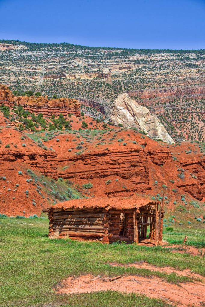 Red mud from the crumbling Moenkopi Formation was used to roof and chink this old cabin, located along the Echo Park Road in Dinosaur National Monument, Colorado.