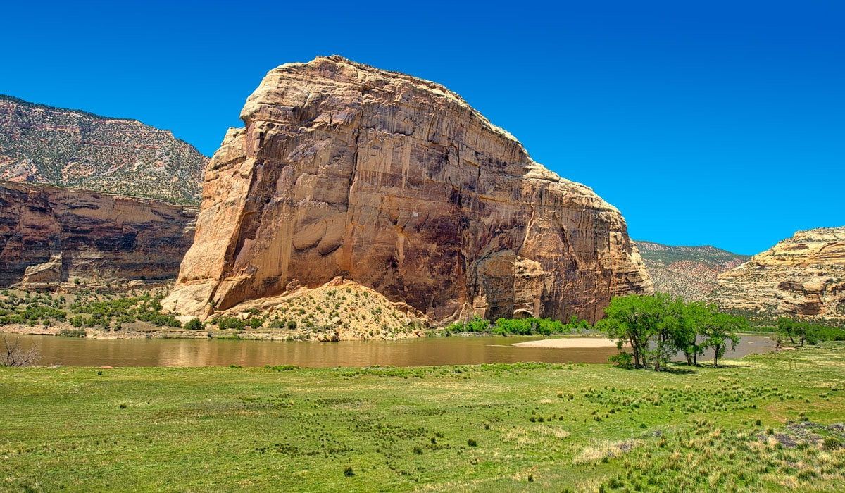This view of Steamboat Rock was taken just downstream of the confluence of the Yampa and Green Rivers. This famous landmark is carved from Weber Sandstone. It is said that explorer John Wesley Powell climbed the rock--somehwhat of a feat for a one-armed man. It is also said that he got trapped on a ledge and had to be rescued by one of his crew.