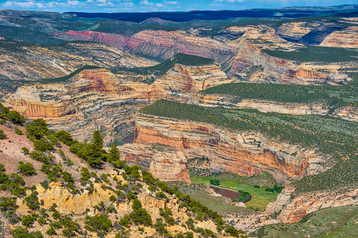 Looking from Canyon Overlook, along the Harpers Corner Road, you can clearly see Echo Park and Steamboat Rock, Just beyon Steamboat, behind the green mesa, is the confluence of the Green and Yampa Rivers.
