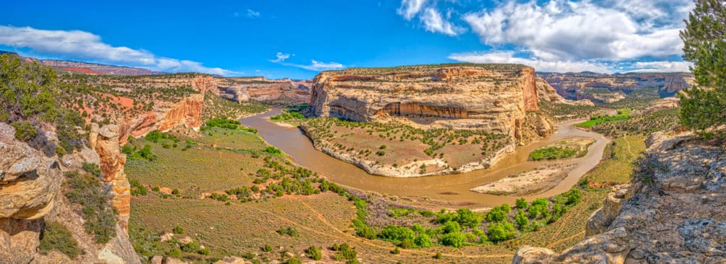 This panorama, taken from a viewpoint at Castle Park Overlook, shows a bend of the Yampa River around the Crows Nest.