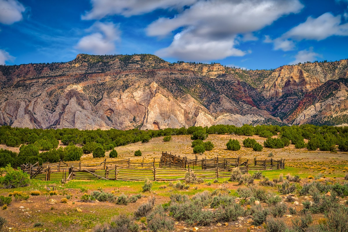 This scenic corral is along side Blue Mountain Road, outside of Dinosaur National Monument. The whitehogbacks on the south side of Blue Mountains are formed from Weber Sandstone.