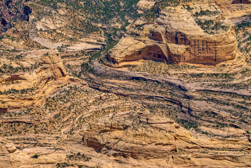 A view of an alcove in the Weber Sandstone on the other side of the Yampa River, near the Mitten Park Fault in Dinosaur National Monument, Colorado.