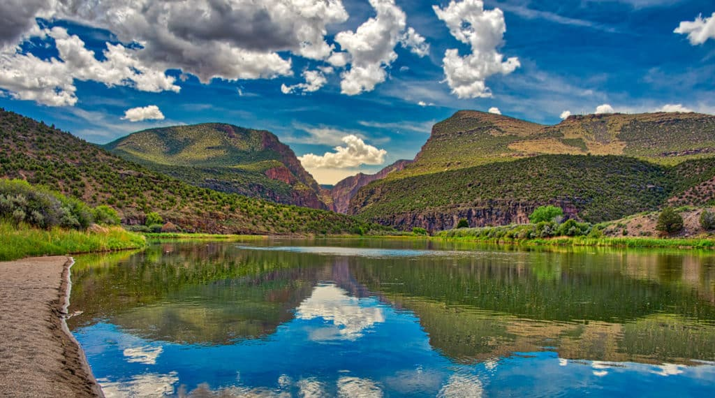 The placid Green River approaches the imposing canyon, known as the Gates of Lodore, beginning its tumultuous journey through the canyon where it will join the Yampa River in Dinosaur National Monument, Colorado.