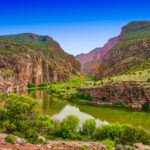 The placid Green River enters the imposing canyon, known as the Gates of Lodore, beginning its tumultuous journey through the canyon where it will join the Yampa River in Dinosaur National Monument, Colorado.