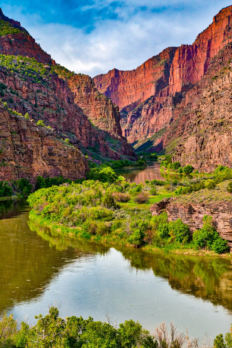The placid Green River enters the imposing canyon, known as the Gates of Lodore, beginning its tumultuous journey through the canyon where it will join the Yampa River at Echo Park in Dinosaur National Monument, Colorado.