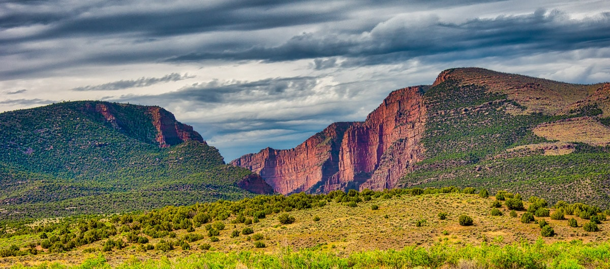 Morning light highlights the the dark red of the Uinta Mountain Group of the Gates of Lodore in Dinosaur National Monument, Colorado. Viewed from the access road into the campground and boat put-in.