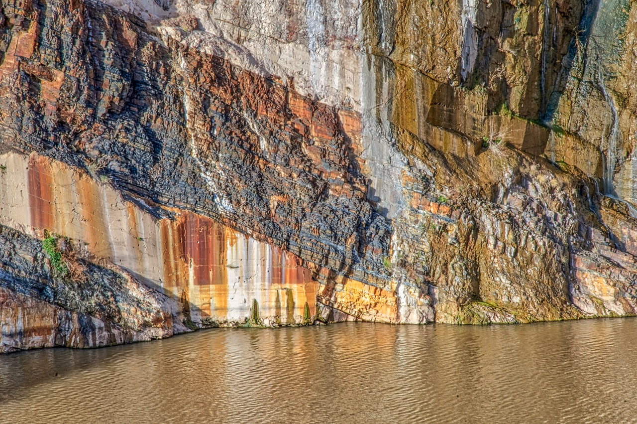Rock layers visible at Theodore Roosevelt Dam along the Salt River on AZ 88 in Arizona.