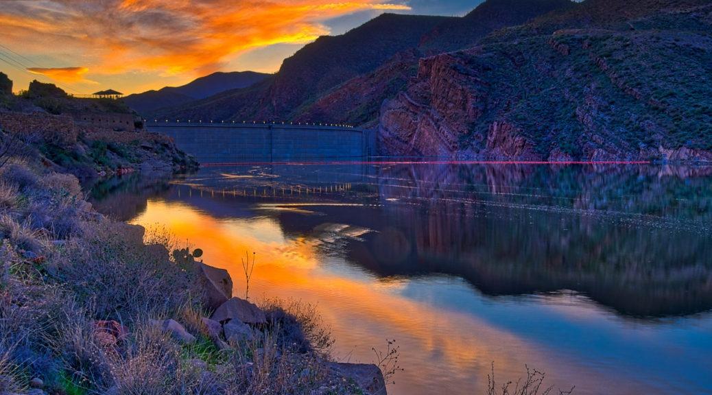 Sunset over Theodore Roosevelt Dam, east of Phoenix, Arizona. Arizona's Apache Trail