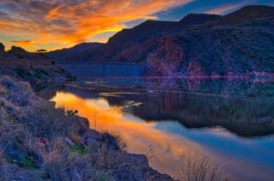 Sunset over Theodore Roosevelt Dam, east of Phoenix, Arizona. Arizona's Apache Trail