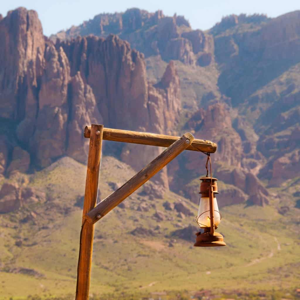 An oil lantern hangs from a post at Goldfield Ghost Town, along the Apache Trail in Arizona.