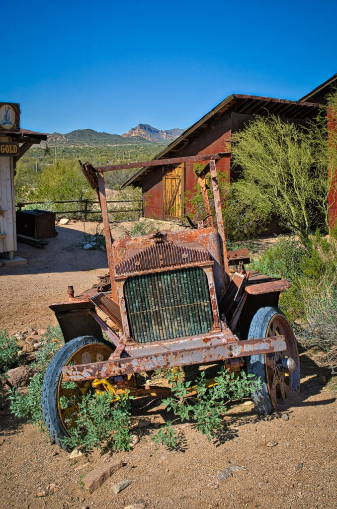 A rusty old truck sits along the street in Goldfield Ghost Town, along the Apache Trail in Arizona.
