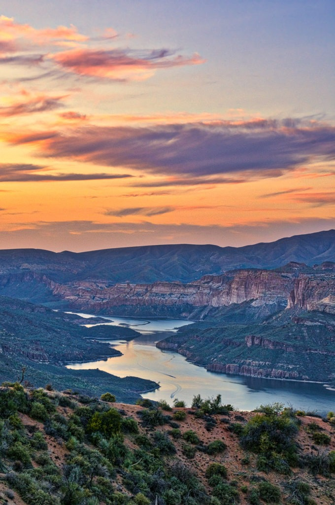 A view of Apache Lake at sunset from the Ravis Trailhead Road, off the apache Trail in Arizona.