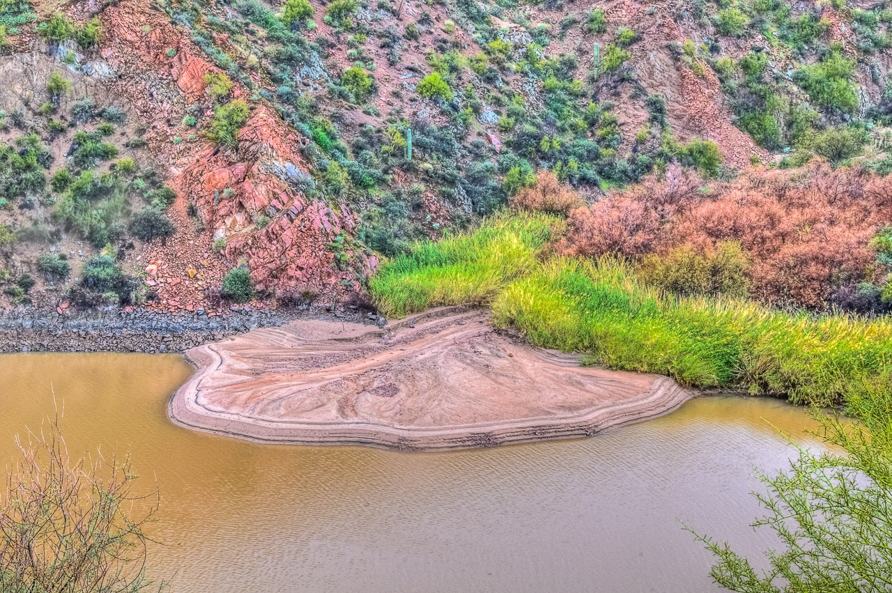 Outflow from a side canyon has formed this classic delta deposit in the Salt River, just downstream from the Theodore Roosevelt Dam, east of Phoenix, Arizona.