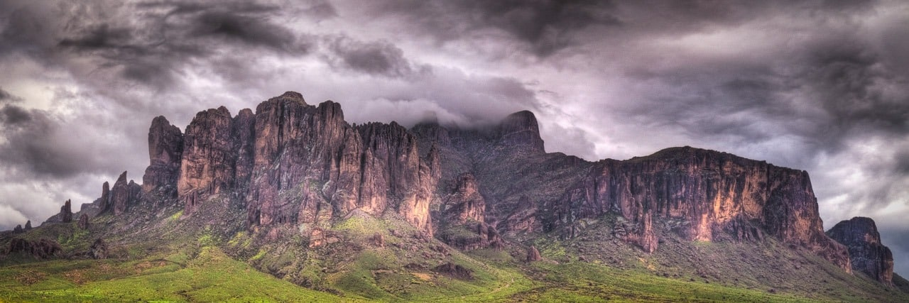 Rainstorm passes over Superstition Mountain, southeast of Apache Junction, Arizona.