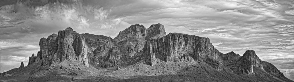 Break in a rainstorm over Superstition Mountain, east of Apache Junction, Arizona.