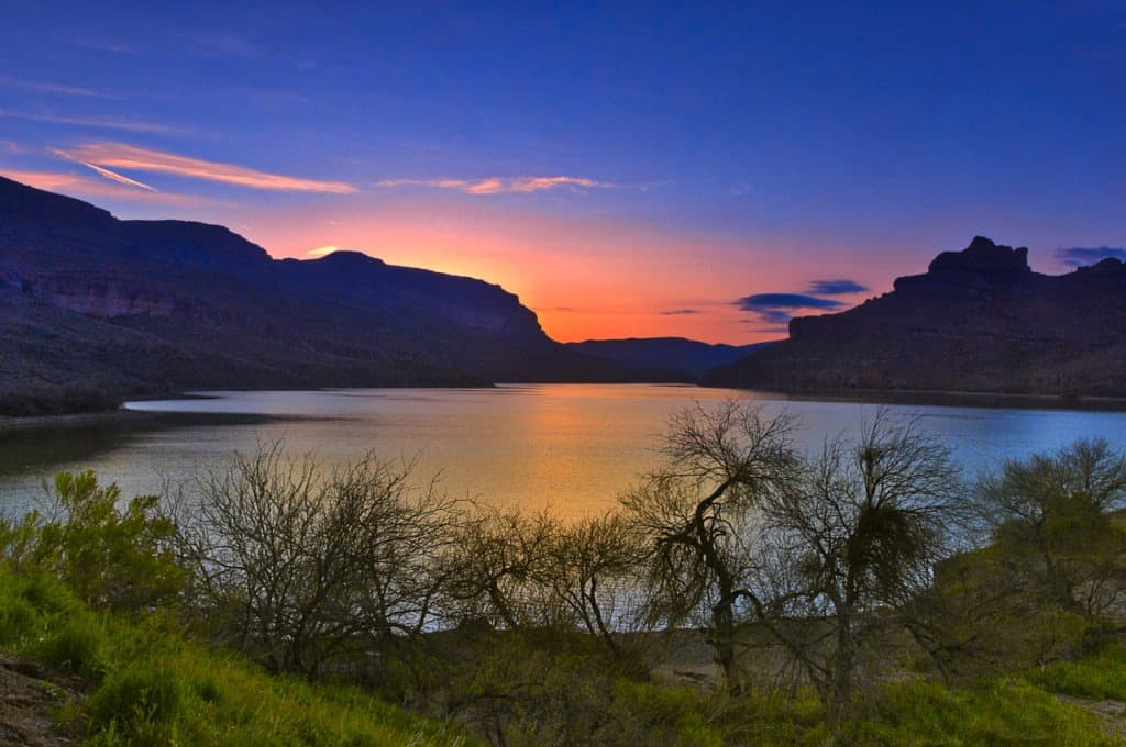 Sunset along the shore of Apache Lake, near Apache Lake Marina and Resort on the Apache trail in Arizona.
