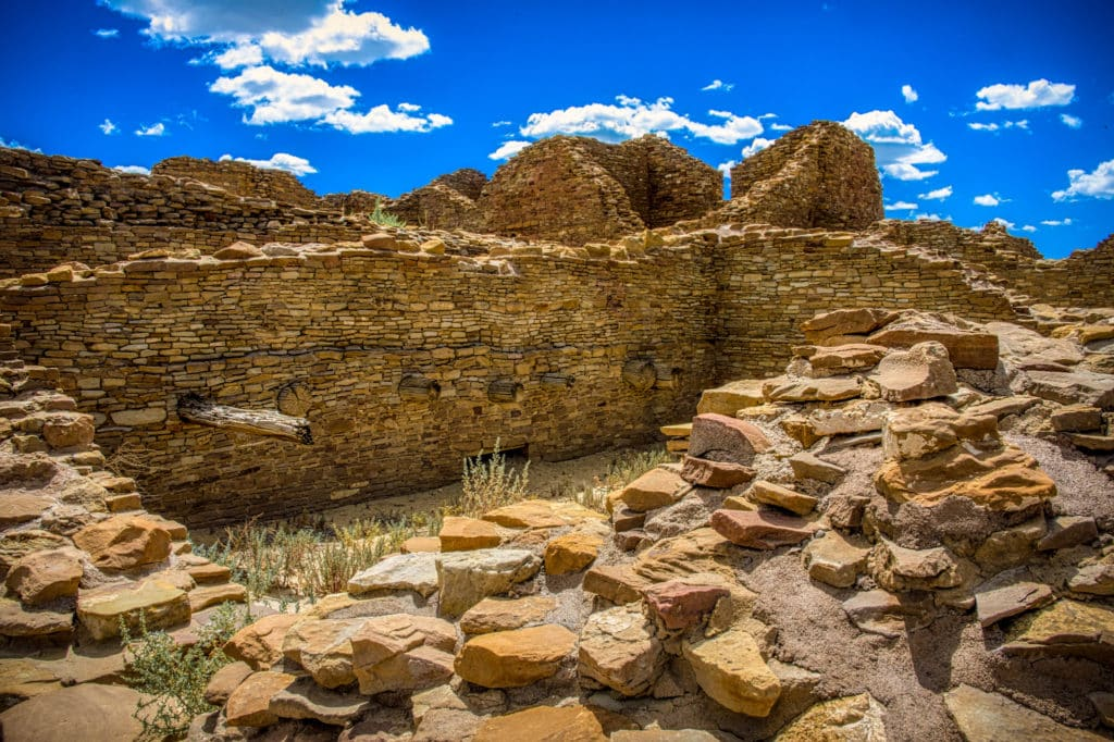 Seven ancient vigas protrude from a first-floor ceiling in a room of the Pueblo del Arroyo great house in Chaco Canyon, New Mexico.