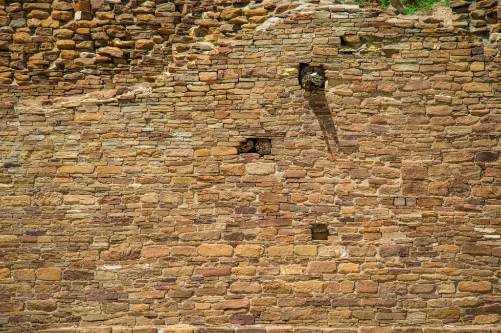 This wall at Pueblo del Arroyo in Chaco Canyon,New Mexico, shows evidence of having been repaired or altered. You can also see ends of vigas, or roof beams, protruding from the wall.