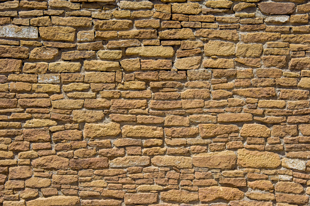 A close-up view of stone veneer on a wall in Pueblo del Arroyo in Chaco Canyon, New Mexico.
