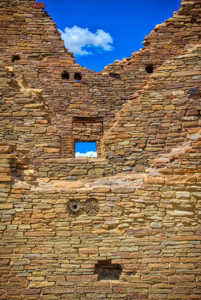 A view through many rooms to a window in Pueblo del Arroyo in Chaco Canyon, New Mexico.