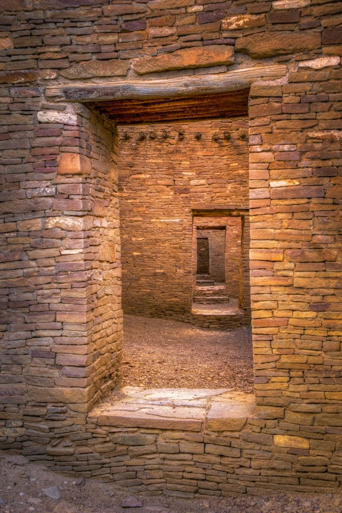 This is one of the most iconic views in Chaco Canyon. It is a shot looking through series of doorways through walls in Pueblo Bonito, located in Chaco Wash, New Mexico.