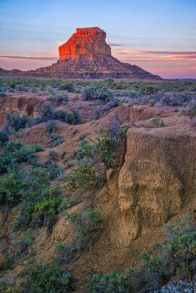 Fajada Butte in Chaco Canyon in New Mexico glows red in the early morning sun.
