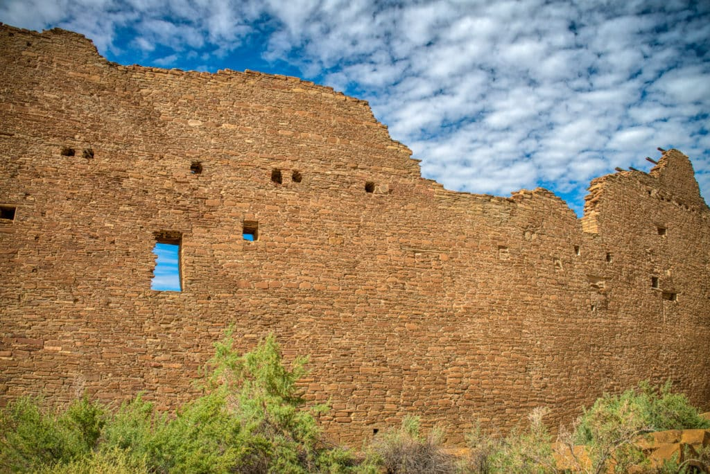 Pueblo Bonito has several masonry styles that help date the initial core ruins and later additions. This is a view of an exterior wall showing core-and-veneer stone work.